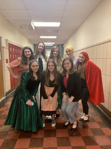 Junior girls pose in costume while getting ready for the show.  From left to right, top row: Sofia Nolfo, Caitlin O'Brien, Madi Willoughby, Caroline Goldenberg, and Sofia Nolfo.  From left to right, bottom row: Abby Stern, Caroline Torpey, and Dylaney Sabino.