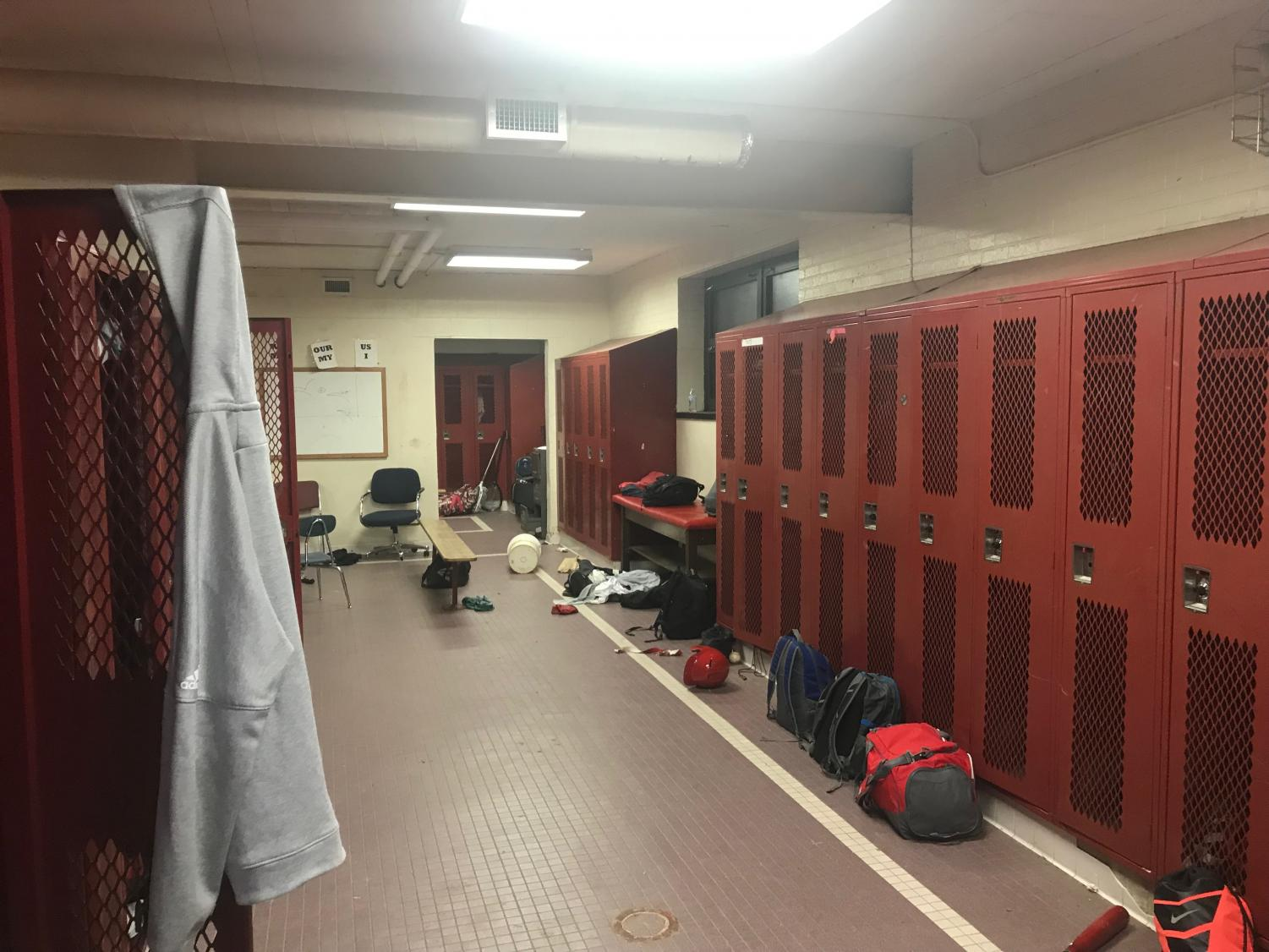A section of the boys' team locker room. Most lockers do not work throughout the room.