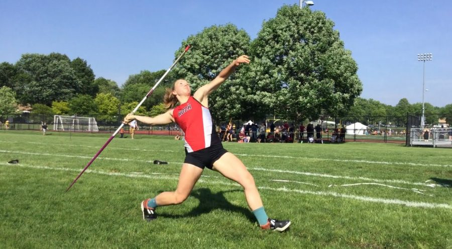 Roze throws a Javelin during a track meet.