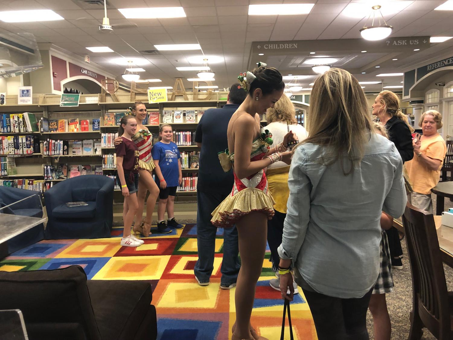 Radio City Rockettes, Megan Levinson and Christine Sienicki, interact with Glen Rock residents at the public library on Sept. 24.