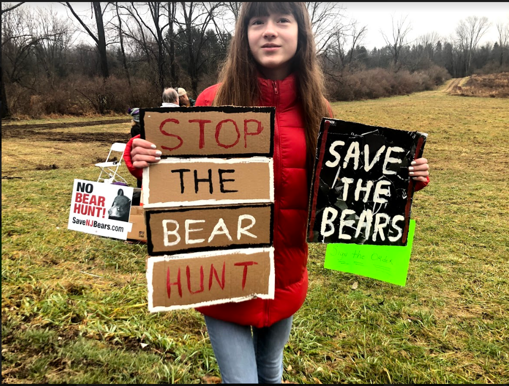 Holding+signs+made+by+her%2C+Gabbi+Krachenfels%2C+a+freshman%2C+supports+the+bear+hunt+protest.+Since+a+young+age%2C+Gabbi+has+been+passionate+about+the+safety+of+animals+and+has+greatly+appreciated+them.+For+almost+three+years%2C+she+has+been+a+vegetarian.+She+often+encourages+her+family+members+and+friends+to+educate+themselves+on+animal+rights+and+safety.+