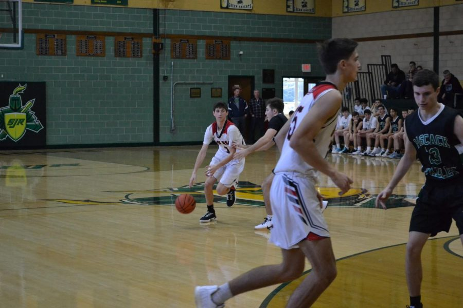 #1 Nick Famularo has earned his respect from his teammates through his two years as a varsity starter at Glen Rock, and was selected as a captain for his senior year. Famularo played a great game, finding open teammates for baskets, and scoring the ball himself.