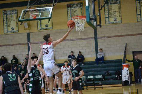 #35 Will McLoughlin soars to the rim to lay the ball in to cut into Pascack Valley's lead in the fourth quarter. McLoughlin, a junior is also a two year starter, and has stepped into an evener larger roll this year for the Panthers.