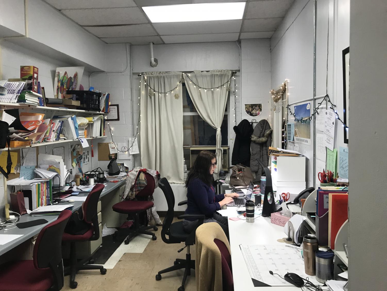 Se%C3%B1ora+Breuer+sits+at+her+desk%2C+lights+had+been+strung+up+around+the+office.