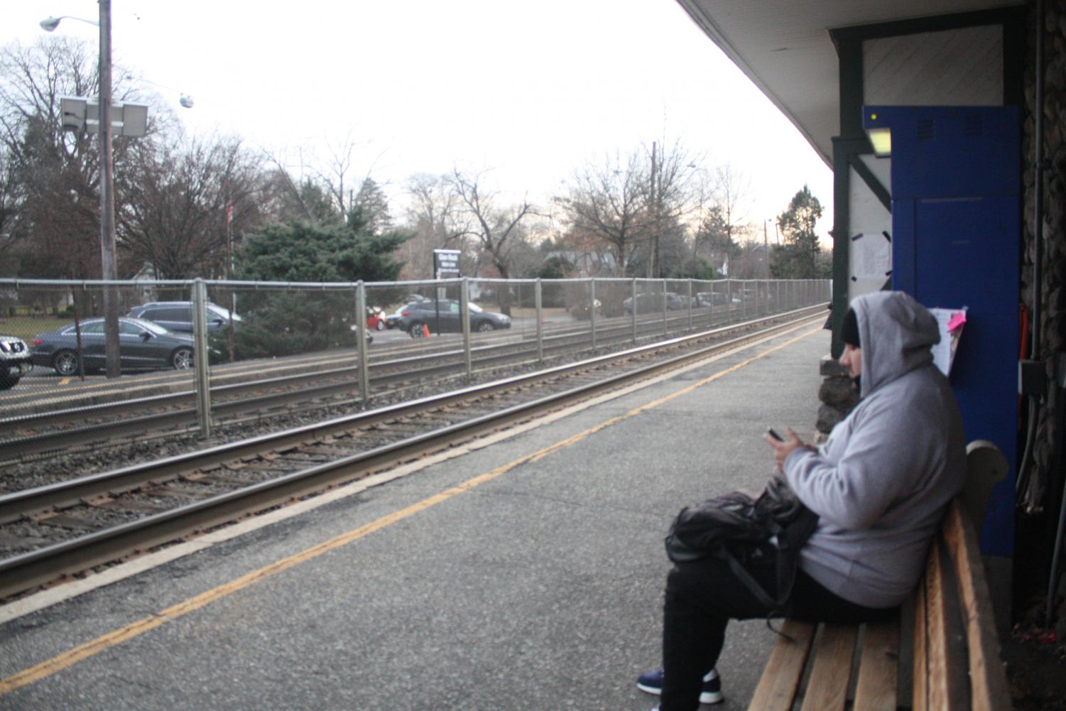 A+man+waits+on+a+bench+for+the+1220+train+heading+to+New+York%2FHoboken+at+3%3A30+p.m.%0A