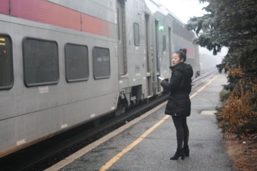 A woman waits on the Glen Rock-Main Line station's platform, waiting to board the 8:33 a.m. Hoboken and New York bound 1706 train.