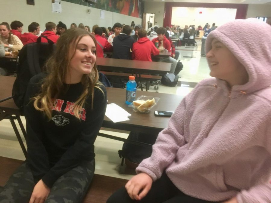 Julianna Patane (left) and Lindsay McDonald (right) pictured during lunchtime in the cafeteria. Patane keeps it cozy in her soft hoodie, while McDonald reps her Glen Rock merch.