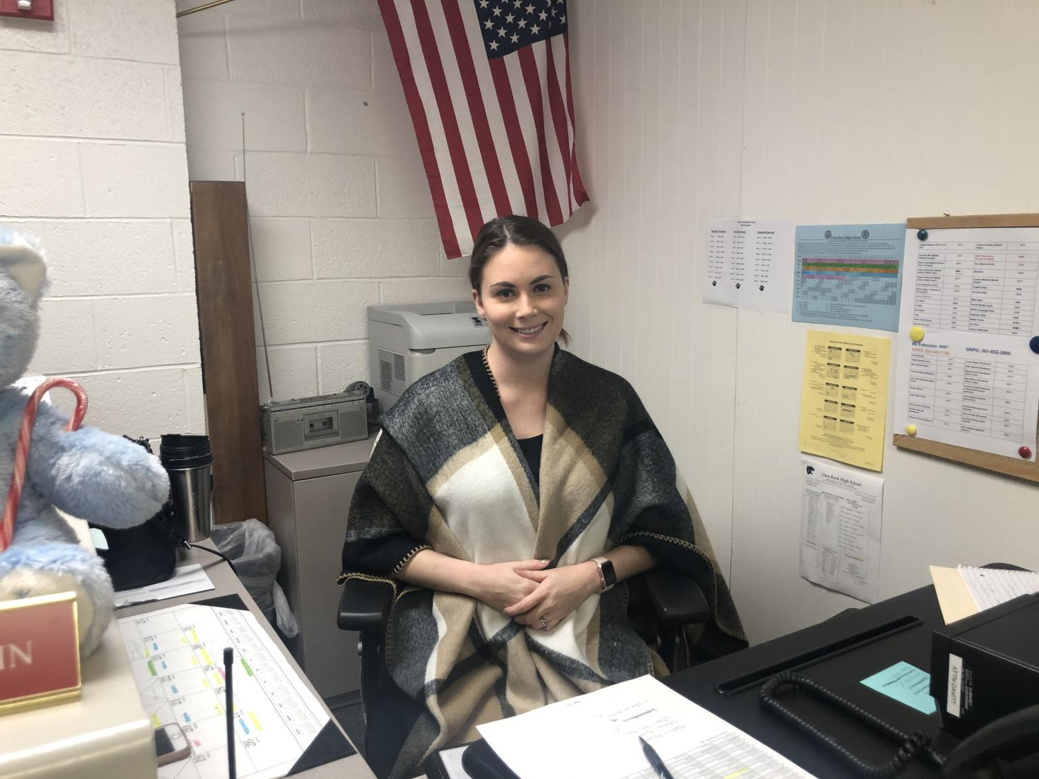 High school Administrative Assistant Rebecca Stadlin works at her desk in the attendance office.