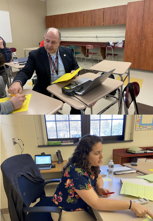 Principal John Arlotta helps math teacher Amanda Sproviero facilitate a portion of her math class as the students learn about polynomials.