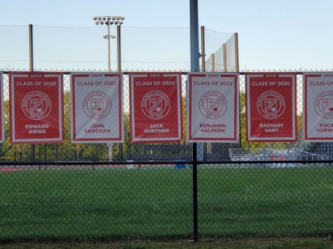Banners have been hung up alongside the fences along the tennis courts and behind the upper turf field, with each banner saying the name of a graduating senior.