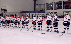 The 2019-2020 squad stands for the National Anthem before their matchup against West Essex.