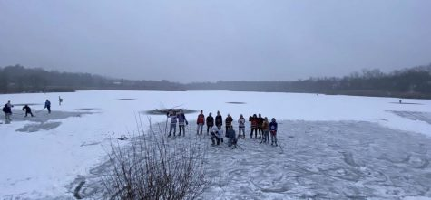 Multiple members of the hockey team laced up the skates for pick up pond hockey at Celery Farms lake in Allendale, New Jersey.