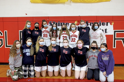 """The whole team stops to pose for a picture while celebrating """"Senior Day"""", an event that, despite COVID-19, the team worked so hard to make happen so they could honor the beloved seniors."""