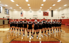 An intimidating portrait of the the whole volleyball team with their matching masks and their crossed arms shows their tenacity to not surrender their competitive nature despite COVID-19 derailing their season.