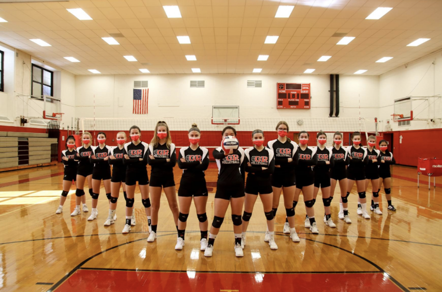 An+intimidating+portrait+of+the+the+whole+volleyball+team+with+their+matching+masks+and+their+crossed+arms+shows+their+tenacity+to+not+surrender+their+competitive+nature+despite+COVID-19+derailing+their+season.