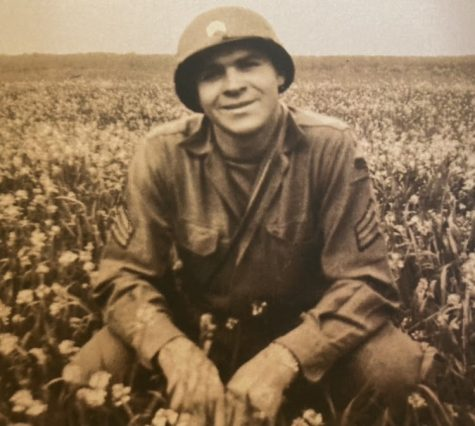 This photograph is of Sgt. Marshall in a field at some point during the war. This image is also the front cover of his book.